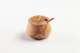 Zuckerdose m. Löffel aus Olivenholz, bombiert, ca. 10 cm.